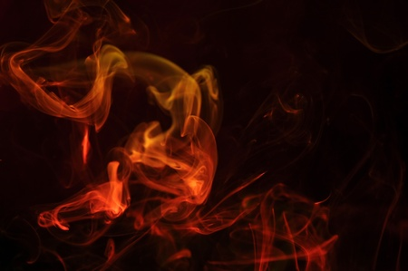 flickering: abstract illuminated red Smoke isolated on a pitch black background