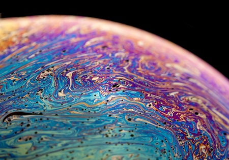 Macro closeup of a colorful soap bubble