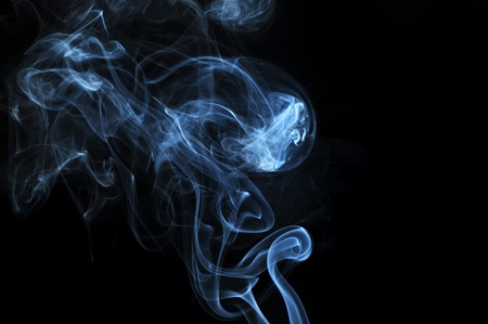 abstract illuminated Smoke isolated on a pitch black background