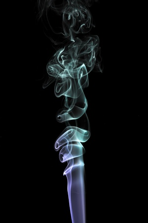 spiralling: abstract illuminated Smoke isolated on a pitch black background