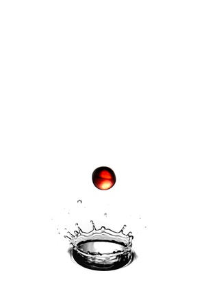 waterdrop: A red waterdrop falling into a splash - highspeed photography