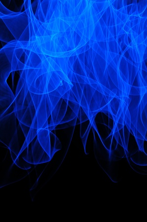wafting: An abstract blue flame long exposure background isolated over a black background.