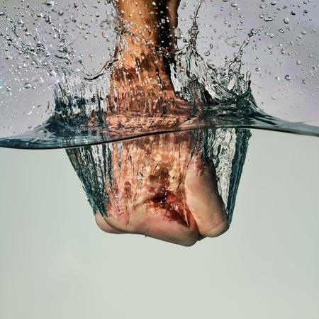 fist punching water