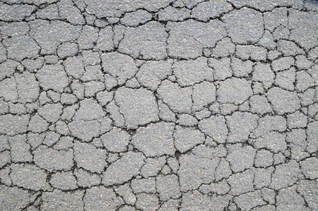 Macro closeup on concrete asphalt cracks on the road Stock Photo - 11960570