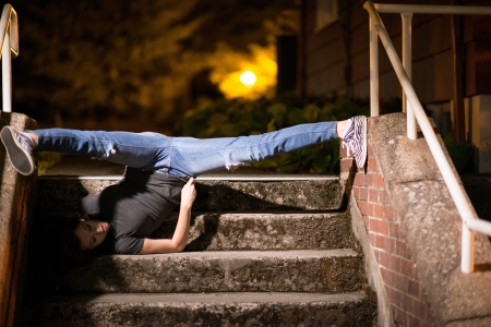 sexy girl dance: A hot female model doing a stunning split upside down on the stairs. Her hear on the floor and feet touching the side walls of stairs.