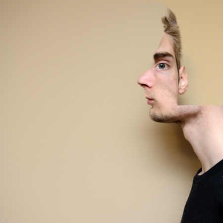 Conceptual illusion portrait of a male model.