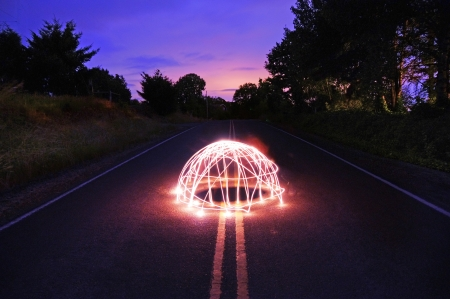 occurrence: Beautiful image of some conceptual lighting done in the middle of a highway road.