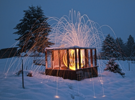 internships: Fabulous lighting and fireworks happening inside a wooden cabin with snow everywhere.