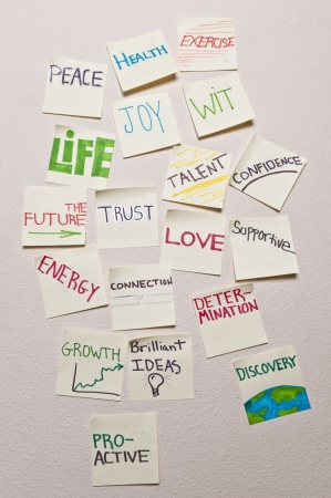 positive thought: Closeup of positive sticky notes - Health, peace, exercise, joy, wit, life, the future, trust, talent, confidence, energy, connection, love, supportive, growth, growth, proactive, discovery