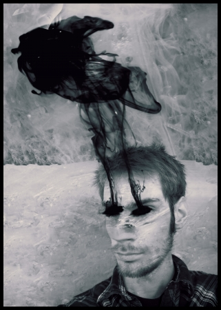 visual perception: A man under water with his eyes missing, with blood or black smoke coming out of them.