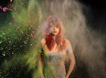 colored powder: Redhead girl with colored powder exploding around her and into the background.