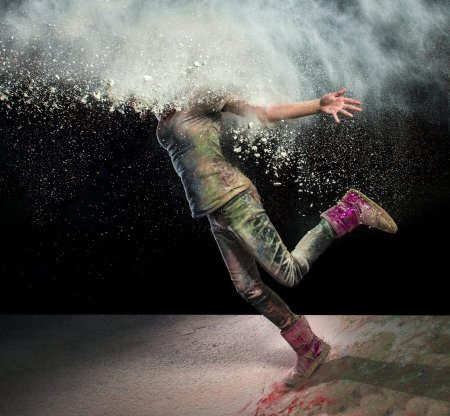 colored powder: Redhead girl with colored powder exploding around her head and into the background. Stock Photo