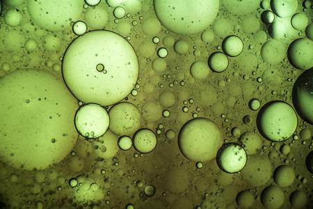 Macro close-up of oil mixed with water looks like a bubble substance.