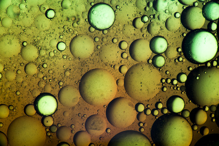full suspended: Macro close-up of oil mixed with water looks like a bubble substance.