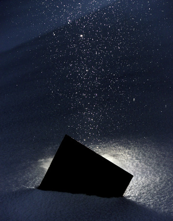 clandestine: Mysterious black square fallen onto the snow. Is it a package, Christmas present, or something else entirely?