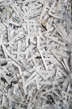 unreadable: Closeup of shredded paper documents from a shredder Stock Photo