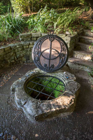 county somerset: The Chalice Well, also known as the Red Spring, is a well situated at the foot of Glastonbury Tor in the county of Somerset, England. Stock Photo