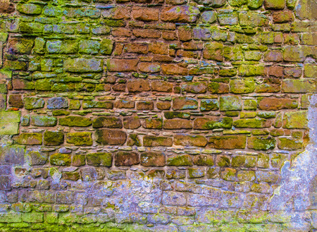 ocher: Old ancient rough cobblestone wall background texture