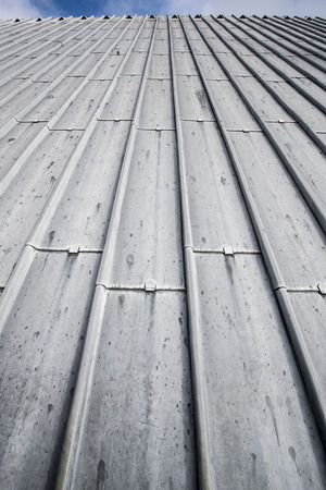 metal structure: Heavy duty sheet metal roof with the horizon line visible at the top Stock Photo