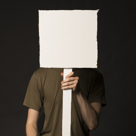 confrontational: Faceless person holding a blank square sign