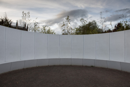 creates: Rounded blank white wall with a patio in the middle creates a circular space