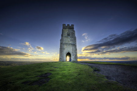 roofless: Glastonbury Tor is a hill at Glastonbury in the English county of Somerset, topped by the roofless St Michaels Tower Stock Photo
