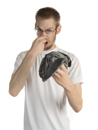 whiff: Young white male in his 20s holding smelly underwear