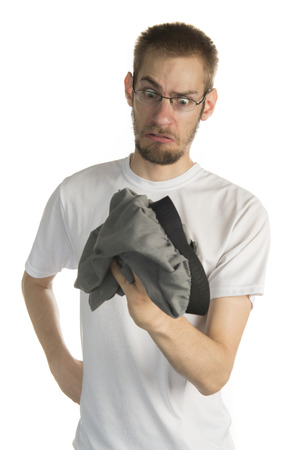 Young white male in his 20s holding smelly underwear photo