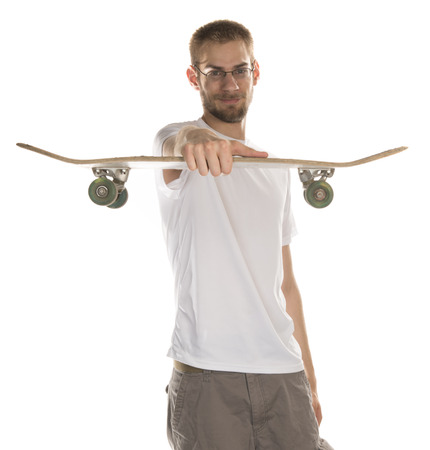 Young white male in his 20s holding a skateboard isolated on white photo