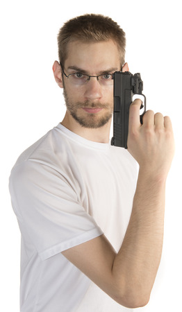 Young white male in his 20s holding a .45 ACP handgun ready for self defense isolated on white background photo