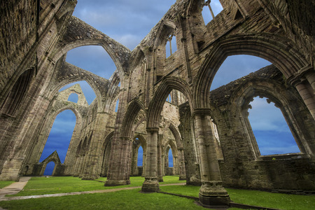 concrete structure: Ruins of Tintern Abbey which is located in Wales UK