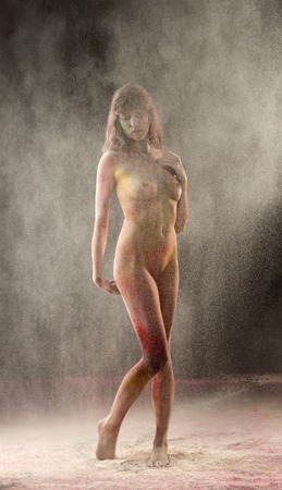 Full Length of Standing Sensual Bare Woman Posing in Studio with Smoke Effect.
