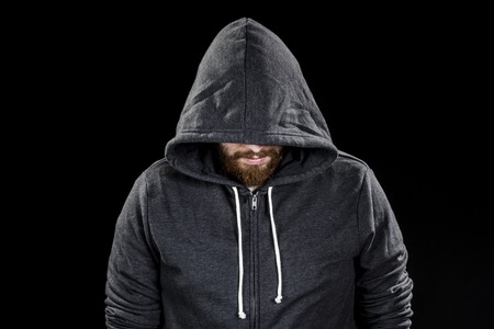 Conceptual White Goatee Man Wearing Gray Hood. Isolated on Black Background.