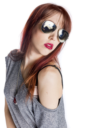 off the shoulder: Glamourous and Fashionable Young Woman Wearing Aviator Style Sunglasses and Grey Off the Shoulder Top on White Background