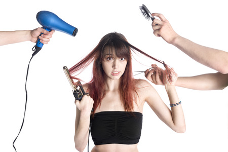 hairstylists: Close up Unhappy Young Woman in Black Tube Tops with Two Hairstylists on Both Sides Styling her Hair, Isolated on White Background. Stock Photo