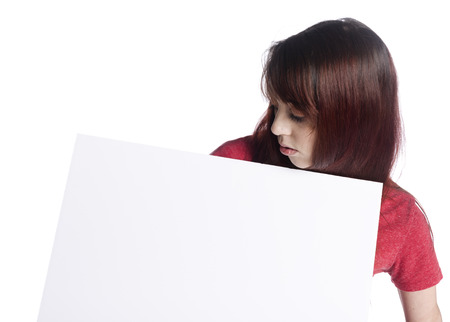 emphasizing: Close up Young Woman Looking at her Blank White Cardboard, Isolated on White Background, Emphasizing Copy Space. Stock Photo