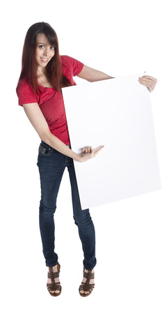 saleslady: Full LEngth Shot of a Young Pretty Woman Holding Blank Empty Cardboard with Copy Space, Isolated on White Background. Stock Photo