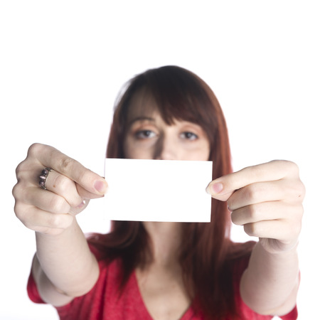 emphasizing: Close up Young Woman Holding Blank White Greeting Card with her Both Hands, Emphasizing Copy Space. Isolated on White Background. Stock Photo
