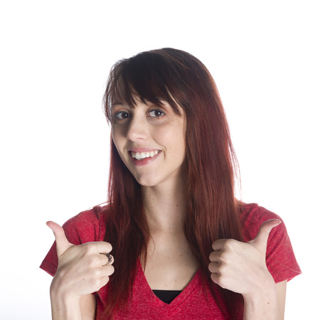 two thumbs up: Close up Happy Young Woman in Red Shirt Showing Two Thumbs up Sign While Looking at the Camera. Isolated on White Background.