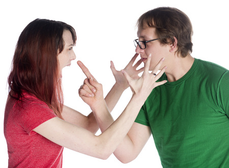 argumentative: Close up Angry Young Couple Facing Each Other, Isolated on White Background.