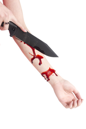 self harm: Conceptual Woman Cutting her Arm with Blood Using Knife, Captured in Close up on White Background. Stock Photo
