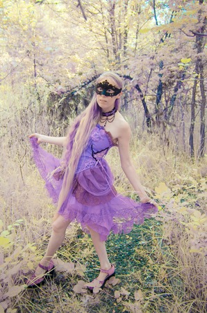 make believe: Full Length Portrait of Woman Wearing Intricate Mask and Gown Walking Outdoors in Forest Setting - Portrait of Mythical Looking Woman in Masquerade Costume