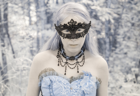 gown: Head and Shoulders Portrait of Woman Wearing Intricate Mask and Gown Outdoors in Forest Setting - Portrait of Mythical Looking Woman in Masquerade Costume
