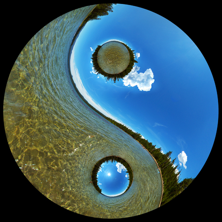 dualism: Yin Yang Balance Concept Image of Pristine Wilderness Lake Scenic with Clear Water, Coniferous Forest, and Blue Sky with White Clouds