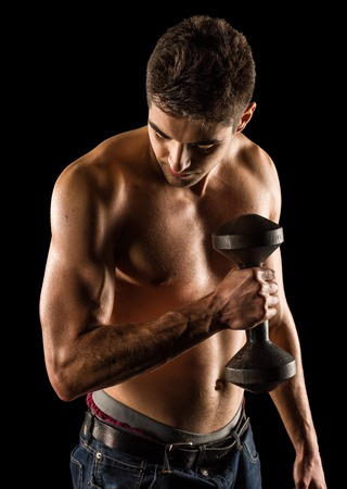 Young Man Working Out Biceps - Dumbbell Concentration Curl