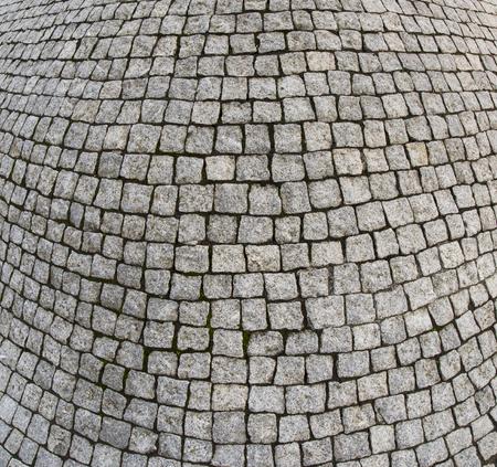 Cement tile curving outward into a bulge Stock Photo