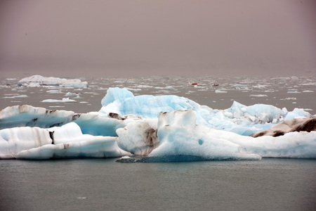 ice sheet: Cracking ice floating on lake