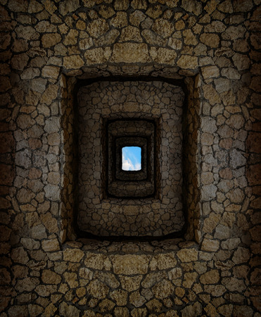 dungeon: Dungeon with stone walls and hard-to-reach hole with blue sky high above Stock Photo