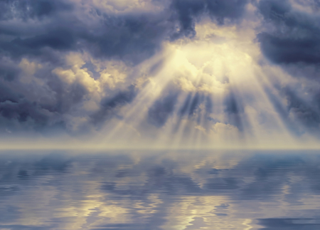 Ray of light breaks through dark stormy sky
