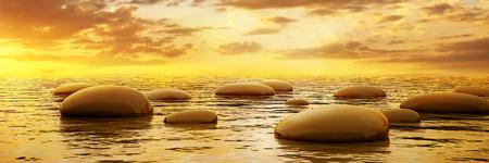 piedras zen: Piedras lisas reflejan en el agua en la puesta del sol vista panorámica Foto de archivo